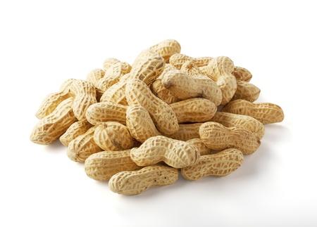 白い背景の上のピーナッツのクローズ アップ 写真素材