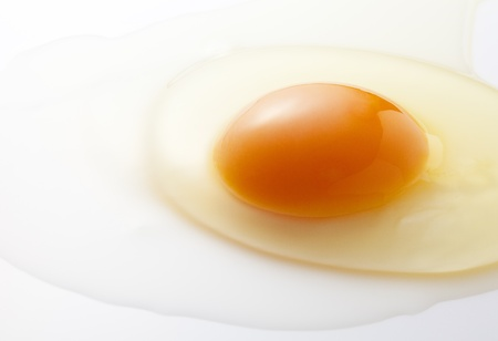 yolk from broken eggs photographed on a light background Stock fotó