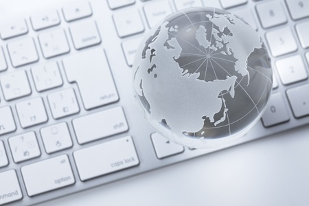 glass globe on a  keyboard photo
