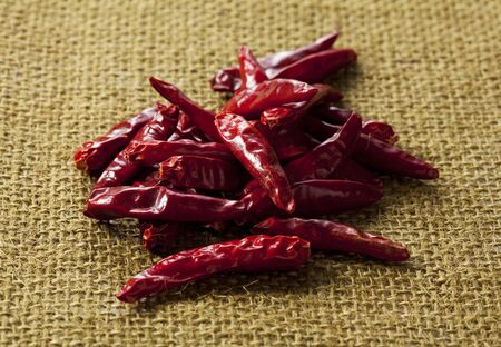 tabasco: Dried red chili peppers on Linen Stock Photo