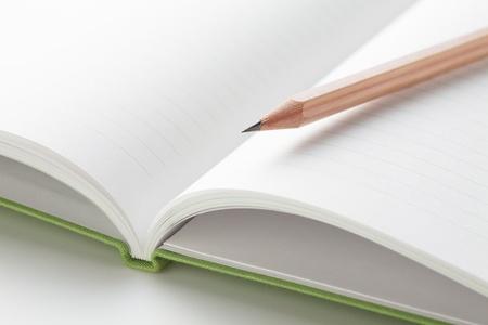 medium close up: Pencil on a Notepad prepared to write Stock Photo