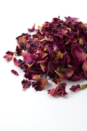dried herbs: Dried rose on white background