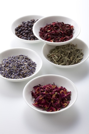 Assortment of dry medicinal herbs in bowls Stock fotó