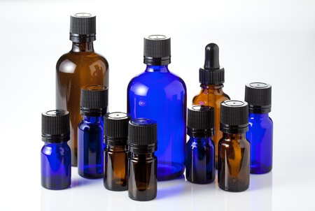 essential oil: blue and brown bottles and dropper