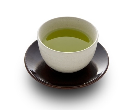 cups of tea: Green tea in a white cup on a white background