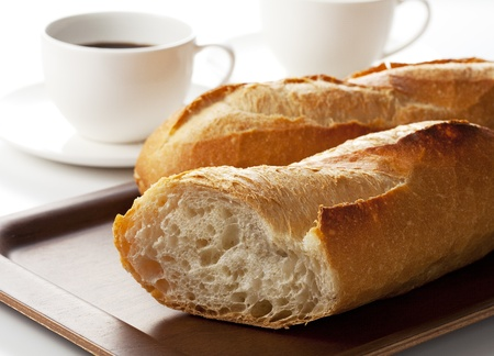 French bread and white cup of black coffee