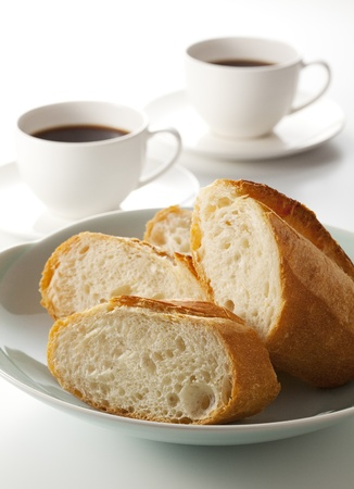 freshly: French bread and white cup of black coffee