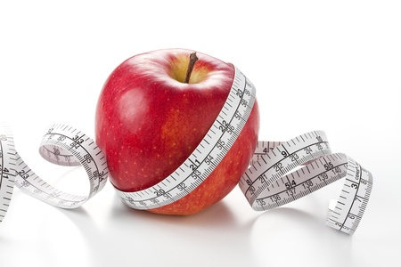 Diet concept - apple and measuring tape isolated on white photo