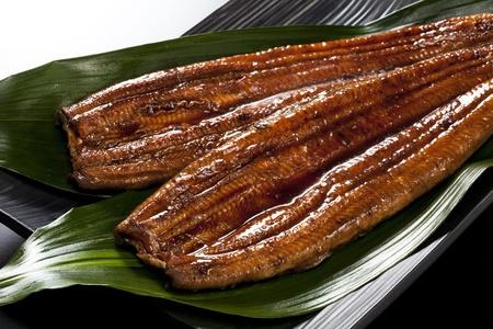 japanese food roast eel ( unagi ) on bamboo grass Stock Photo