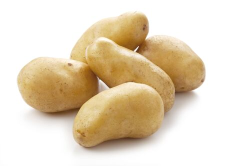 Fresh potatoes on a white background Stock Photo - 10914712