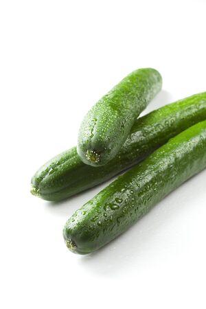 cuke: The green cucumbers  on white background