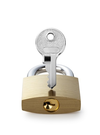 Metal padlock and key on white background photo