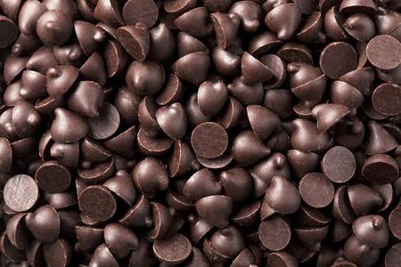 バック グラウンドでレイアウトされているチョコレート チップ 写真素材