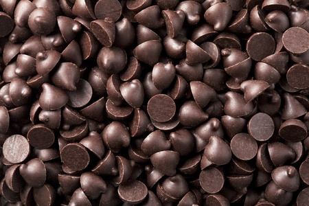 Chocolate chips that are laid in the background photo