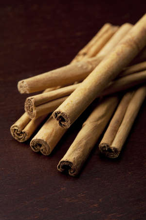 Cinnamon stick was placed on top of the wooden board Stock Photo - 12730369