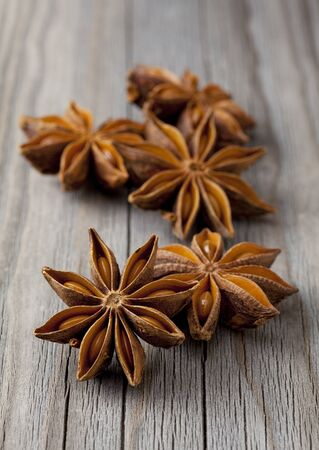 Star anise was placed on top of the wooden board Stock Photo - 12730292