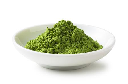 polvo de té verde en el plato Foto de archivo