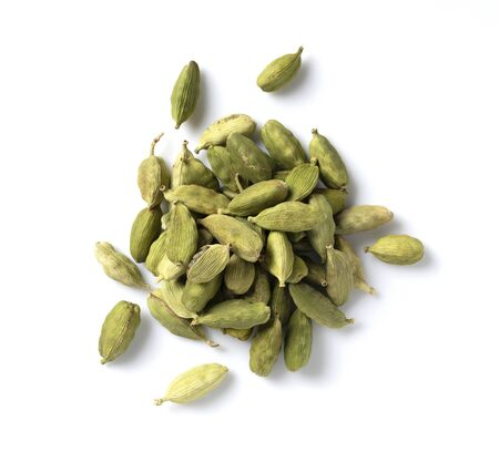 Cardamom seeds placed on a white background