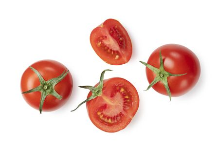 Tomatoes placed on white background and cut tomatoes shot from above Reklamní fotografie