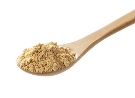 Japanese Kinako in a wooden spoon on a white background, photographed from an angle