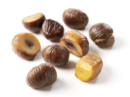 Various shapes of chestnuts on a white background