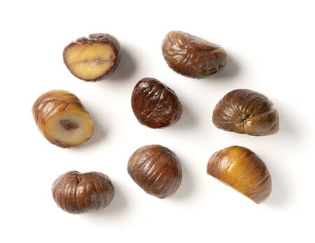 Various shapes of chestnuts on a white background Stock Photo