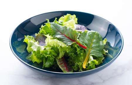 Various salad leaves on a plate