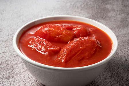Tomato puree in a white bowl Archivio Fotografico