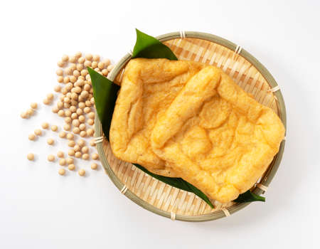 Japanese fried tofu and soybeans on a white background