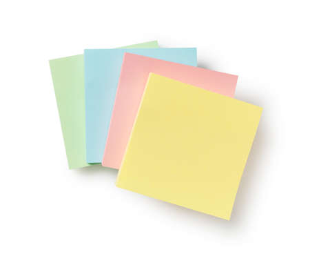 Four colorful sticky notes on a white background Foto de archivo