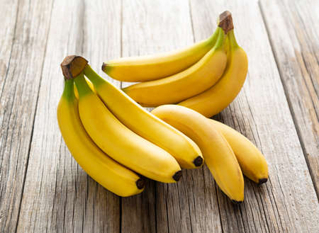Close up of a banana placed on an old wooden board