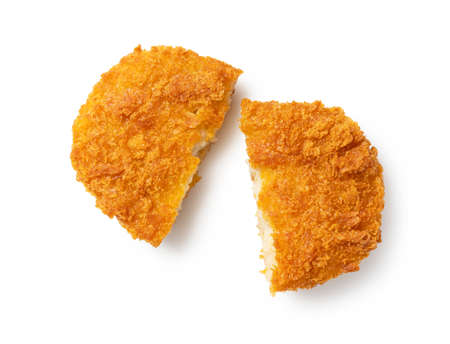 A cut croquette placed on a white background. A view from above.