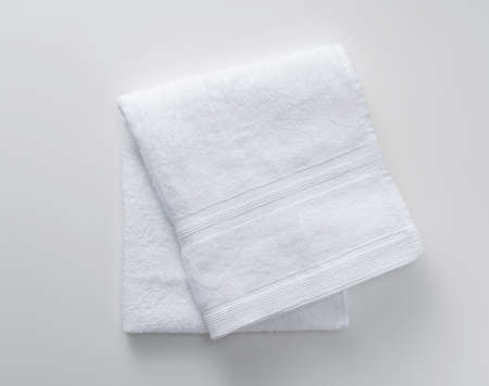 A white towel on a white background. View from above