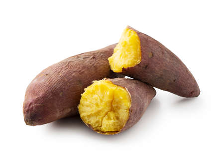 Close-up of a sweet potato split in half on a white background
