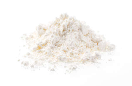 Flour placed on a white background. Close-up photo