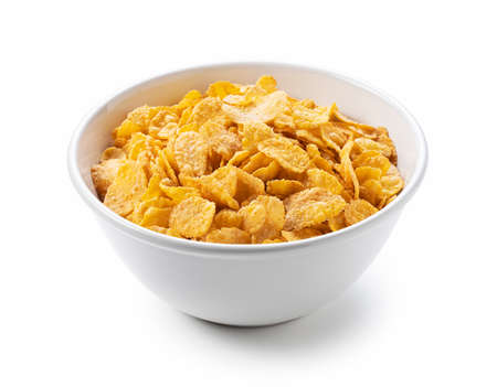 Cornflakes in a white ceramic bowl set against a white background. Banque d'images