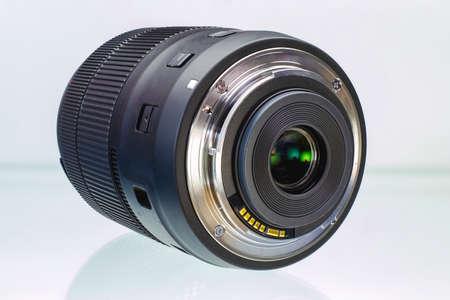 Camera or photo camera lens on a white background. Close-up. Macro shooting Foto de archivo
