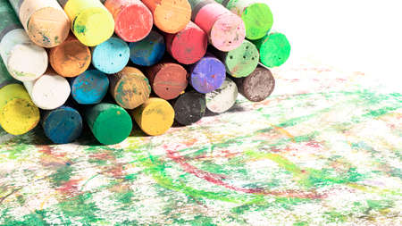Multi-colored pastel crayons. Materials for drawing and creativity. Bright water-based paints. School supplies. Hobbies and creativity.