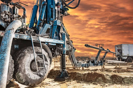 Drilling rig works on site at sunset. Close-up. Deep hole drilling. Geological exploration work. Mineral exploration. Powerful drill drills a well
