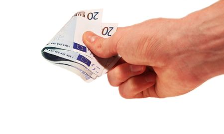 denominations: Hand and money on a white background Stock Photo