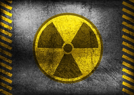 risk of war: Nuclear radiation symbol on grunge wall background