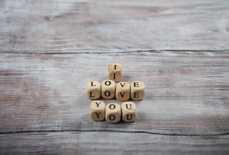 love image: I love you lettering on small cubes. Rustic wooden texture