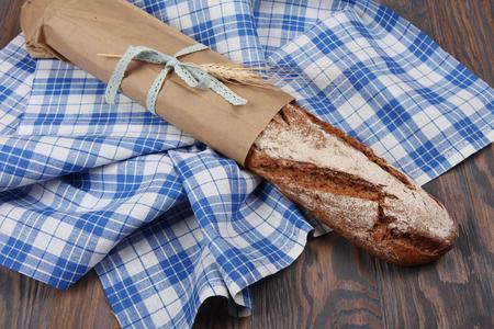 long loaf: Homemade baked rye long loaf on blue towel