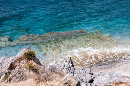 greece granite: Turquoise sea with pristine waters and rocky bottom at Ulash Beach in Alanya Turkey