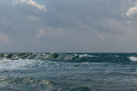 Seastorm shot on cloudy day with beautiful powerful waves Stock Photo