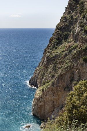 steep cliff descending to turquoise beautiful mediterranean sea