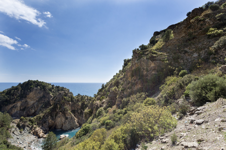 Seascape of Antiochia ad Cragum bay and beautiful lagoon with mountains descending to sea shot on sunny day