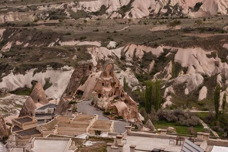 geological formation: landscape of Cappadocia with fairy chimneys and roofs of stone houses