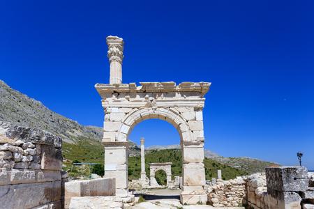 Ancient city Sagalassos ruins columns, sculpture and big stones