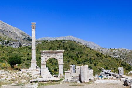 friso: Ancient city Sagalassos ruins columns, sculpture and big stones